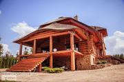 Zdjęcie do ogłoszenia: Dom z bala wykończony płytkami z kamienia naturalnego